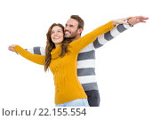 Купить «Young couple standing with arms outstretched», фото № 22155554, снято 7 октября 2015 г. (c) Wavebreak Media / Фотобанк Лори