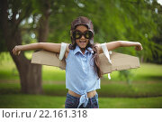 Купить «Young girl pretending to fly», фото № 22161318, снято 26 ноября 2015 г. (c) Wavebreak Media / Фотобанк Лори