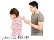Купить «Young man and young woman into an argument», фото № 22163510, снято 7 октября 2015 г. (c) Wavebreak Media / Фотобанк Лори