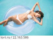 Купить «Beautiful woman relaxing on swim ring at swimming pool», фото № 22163586, снято 4 ноября 2015 г. (c) Wavebreak Media / Фотобанк Лори