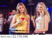 Купить «Pretty girls with cocktails», фото № 22176046, снято 22 сентября 2015 г. (c) Wavebreak Media / Фотобанк Лори
