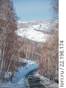 Купить «Зимняя дорога в Башкирии  вдоль озера Яктыкуль», фото № 22198174, снято 9 марта 2016 г. (c) Ирина Гришанова / Фотобанк Лори