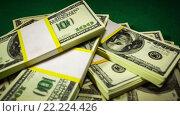 Купить «Пачки долларов лежат на зелёном сукне», видеоролик № 22224426, снято 28 января 2016 г. (c) Андрей Армягов / Фотобанк Лори