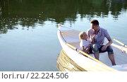 Купить «Dad and son in a boat on lake», видеоролик № 22224506, снято 16 марта 2016 г. (c) Raev Denis / Фотобанк Лори
