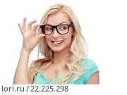 Купить «happy young woman or teenage girl in glasses», фото № 22225298, снято 13 февраля 2016 г. (c) Syda Productions / Фотобанк Лори