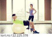Купить «smiling man and woman with exercise ball in gym», фото № 22225378, снято 5 апреля 2015 г. (c) Syda Productions / Фотобанк Лори