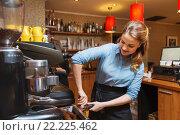 Купить «barista woman making coffee by machine at cafe», фото № 22225462, снято 1 декабря 2015 г. (c) Syda Productions / Фотобанк Лори