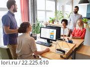 happy creative team talking in office. Стоковое фото, фотограф Syda Productions / Фотобанк Лори