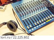 Купить «control panel at recording studio or radio station», фото № 22225802, снято 8 апреля 2015 г. (c) Syda Productions / Фотобанк Лори
