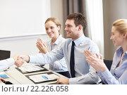 Купить «smiling business team shaking hands in office», фото № 22226058, снято 25 октября 2014 г. (c) Syda Productions / Фотобанк Лори