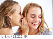 happy young women whispering gossip at home. Стоковое фото, фотограф Syda Productions / Фотобанк Лори