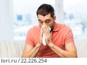 Купить «sick man blowing nose to paper napkin at home», фото № 22226254, снято 15 января 2016 г. (c) Syda Productions / Фотобанк Лори