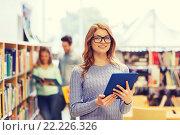 Купить «happy student girl with tablet pc in library», фото № 22226326, снято 6 марта 2015 г. (c) Syda Productions / Фотобанк Лори