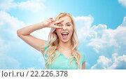 Купить «smiling young woman or teenage girl showing peace», фото № 22226378, снято 13 февраля 2016 г. (c) Syda Productions / Фотобанк Лори