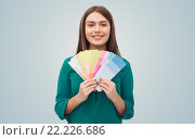 Купить «smiling young woman with color swatches», фото № 22226686, снято 19 февраля 2016 г. (c) Syda Productions / Фотобанк Лори