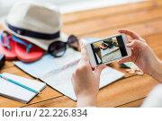 Купить «close up of woman with smartphone and travel stuff», фото № 22226834, снято 8 февраля 2016 г. (c) Syda Productions / Фотобанк Лори