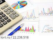 Купить «Калькулятор, графики, диаграммы и ручка. Бизнес-натюрморт», эксклюзивное фото № 22238518, снято 14 марта 2016 г. (c) Юрий Морозов / Фотобанк Лори
