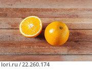 Купить «Orange fruit and slice  on wooden table», фото № 22260174, снято 15 декабря 2017 г. (c) PantherMedia / Фотобанк Лори