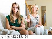 Sad woman and mature mother having conflict. Стоковое фото, фотограф Яков Филимонов / Фотобанк Лори