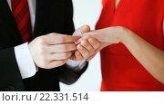 Купить «groom putting a wedding ring to bride hand», видеоролик № 22331514, снято 16 марта 2016 г. (c) Syda Productions / Фотобанк Лори