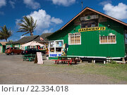 Купить «Handicraft shops selling ice coconut sweet corn and tropical fruits Kahuku north shore Oahu Hawaii USA.», фото № 22334018, снято 20 октября 2007 г. (c) age Fotostock / Фотобанк Лори