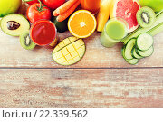 Купить «close up of fresh juice glass and fruits on table», фото № 22339562, снято 17 марта 2015 г. (c) Syda Productions / Фотобанк Лори