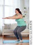 Купить «plus size woman exercising on mat at home», фото № 22339878, снято 21 февраля 2016 г. (c) Syda Productions / Фотобанк Лори