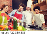Купить «happy friends and chef cook cooking in kitchen», фото № 22339886, снято 12 февраля 2015 г. (c) Syda Productions / Фотобанк Лори
