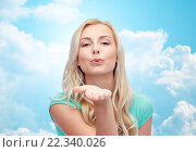 Купить «smiling young woman or teen girl sending blow kiss», фото № 22340026, снято 13 февраля 2016 г. (c) Syda Productions / Фотобанк Лори