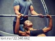 Купить «man and woman with barbell flexing muscles in gym», фото № 22340662, снято 19 апреля 2015 г. (c) Syda Productions / Фотобанк Лори