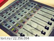 Купить «control panel at recording studio or radio station», фото № 22356094, снято 8 апреля 2015 г. (c) Syda Productions / Фотобанк Лори