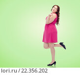 Купить «happy young plus size woman and sending blow kiss», фото № 22356202, снято 21 февраля 2016 г. (c) Syda Productions / Фотобанк Лори