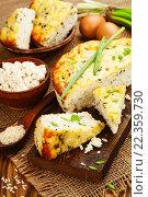 Купить «Запеканка из риса, творога и зеленого лука на деревянной столе», фото № 22359730, снято 25 марта 2016 г. (c) Надежда Мишкова / Фотобанк Лори