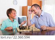 Купить «Man and teenager son playing chess», фото № 22360594, снято 20 сентября 2018 г. (c) Яков Филимонов / Фотобанк Лори