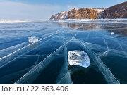 Купить «Байкал. Зимний пейзаж с прозрачными льдинками на гладкой синей поверхности льда», фото № 22363406, снято 6 марта 2016 г. (c) Виктория Катьянова / Фотобанк Лори