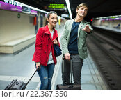 Купить «Young couple standing at underground station», фото № 22367350, снято 23 июля 2019 г. (c) Яков Филимонов / Фотобанк Лори