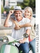 Купить «Smiling couple sitting motor scooter», фото № 22393066, снято 11 декабря 2015 г. (c) Wavebreak Media / Фотобанк Лори