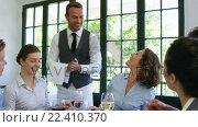 Купить «Waiter bringing plates to business people», видеоролик № 22410370, снято 22 июля 2018 г. (c) Wavebreak Media / Фотобанк Лори