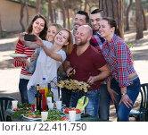 Купить «Smiling colleagues making mutual photo», фото № 22411750, снято 14 августа 2018 г. (c) Яков Филимонов / Фотобанк Лори