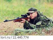 Купить «young soldier or hunter with gun in forest», фото № 22440774, снято 14 августа 2014 г. (c) Syda Productions / Фотобанк Лори