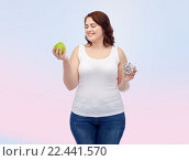 Купить «happy plus size woman choosing apple or donut», фото № 22441570, снято 21 февраля 2016 г. (c) Syda Productions / Фотобанк Лори