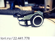 Купить «headphones at recording studio or radio station», фото № 22441778, снято 8 апреля 2015 г. (c) Syda Productions / Фотобанк Лори