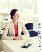 Купить «happy woman sitting at table in restaurant», фото № 22441918, снято 30 апреля 2015 г. (c) Syda Productions / Фотобанк Лори