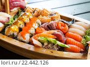 Купить «sushi set at restaurant», фото № 22442126, снято 13 февраля 2016 г. (c) Syda Productions / Фотобанк Лори