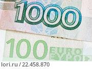 Купить «Фрагмент банкнот в 100 евро и 1000 рублей, крупный план», фото № 22458870, снято 3 апреля 2016 г. (c) Екатерина Овсянникова / Фотобанк Лори