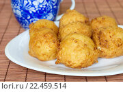 Купить «Пончики творожные домашнего приготовления», фото № 22459514, снято 3 апреля 2016 г. (c) Елена Коромыслова / Фотобанк Лори
