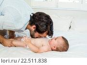 Купить «Playful father with cute baby boy on bed», фото № 22511838, снято 18 декабря 2015 г. (c) Wavebreak Media / Фотобанк Лори