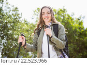 Купить «Smiling woman nordic walking», фото № 22523966, снято 1 октября 2015 г. (c) Wavebreak Media / Фотобанк Лори