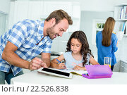 Купить «Happy father assisting daughter in homework at home», фото № 22526838, снято 18 декабря 2015 г. (c) Wavebreak Media / Фотобанк Лори