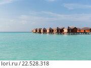 Купить «bungalow huts in sea water on exotic resort beach», фото № 22528318, снято 11 февраля 2016 г. (c) Syda Productions / Фотобанк Лори
